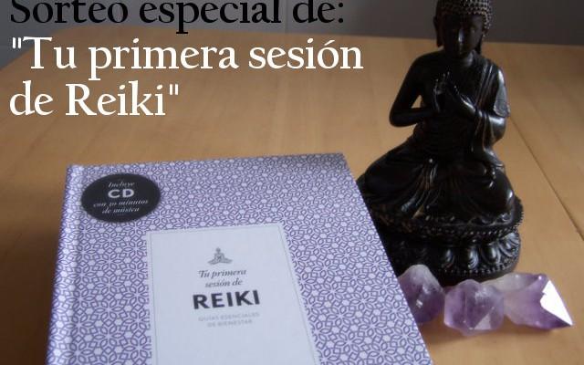el libro tu primera sesion de reiki junto a una figura de buda y tres puntas de amatista