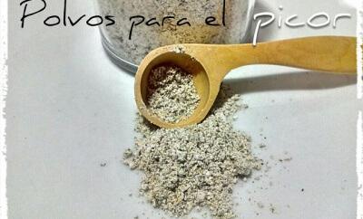 bote y cucharilla con plantas medicinales trituradas
